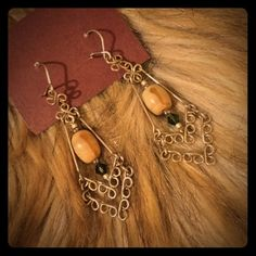 Artisan Drop Earrings *Listed as Anthro for exposure* These are silver nickel drop earrings with glass beads. The larger bead is a cream color with a tan stripe down the middle. The bottom bead is a dark green. Total length 2.25 inches. Never worn. Anthropologie Jewelry Earrings