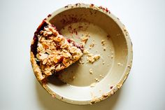 This berry almond streusel pie is stuffed with juicy, mixed berries and topped with a buttery, almond specked crumb topping.