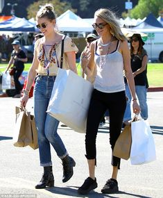 Good times: Amber and Cara smiled as they strolled together