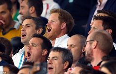 Prince Harry, dressed in an England shirt, sings God Save The Queen ahead of the match alo...