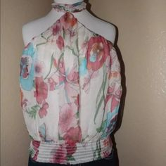 BEAUTIFUL HALTER TOPNWOT!!SO CUTE!!! Lovely halter top by bebe Lightweight and so soft. Ties at the back of the neck. Multi-colored in a sweet floral pattern. Perfect for the season's spring or summer picnics and barbecues. Can be worn under a jacket as career wear. Easily transitions from work to play. It's really a nice, sexy top! NWOT!! (BTW...jeans aren't included in this sale!). bebe Tops