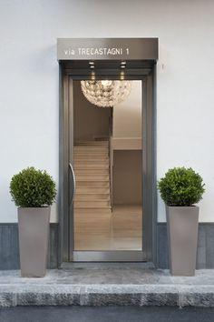 white architecture, catania bulding, la vela, hall door