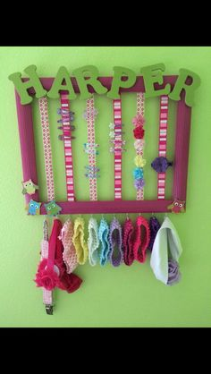 Organise your daughters head bands and clips. Remove glass and backing to photo frame, paint, decorate.. Add name with letters if you wish ❤️