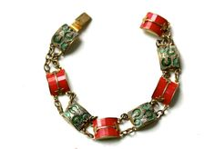 Art deco bracelet with red galalith  and green molded glass linked pannels elements in goldtone setting