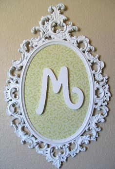 SHABBY CHIC Nursery Baby Nursery Decor-Family Crest-Monogram-Framed Magnet Board-Memo Board-Bulletin Board-White Ornate Vintage Frame- this is $230 via ETSY put im pretty sure I could DIY it quite easily!
