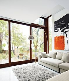 A sliding door by Bauhaus Fine Windows and Doors leads from the addition into the backyard. Architect Drew Mandel