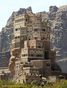 Dar Al Hajar,  Wadi Dhahr Valley, Yemen....     www.castlesandmanorhouses.com    ....     Dar al-Hajar, also known as the Imam's Rock Palace is perched on top of a rock pinnacle, some 15 km away from the capital city of Sana. It is typical of Yemeni architecture, seeming to grow out of the rocks on which it is constructed, and with characteristic Yemeni painting of its windows and building edges. The palace was built in the 1930s by Imam Yahya as his summer residence.