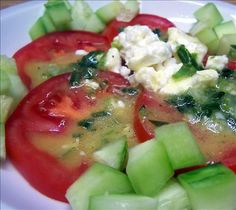 Tomato and Cucumber Salad With Feta and Honey Mustard Dressing from Food.com:   								I make this quite when my garden is overflowing with large ripe juicy tomatoes and with cucumbers. This is an easy and simple side dish with lots of flavor. Serve on a large serving plate with the chopped cucumbers around the tomatoes. If possible try to make up the dressing well in advance and chill until ready to use, it can even be made up a day ahead. You will love this!