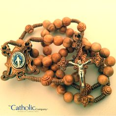 Our Olive Wood Corded Miraculous Medal Rosary is one of our all-time best-selling rosaries. Made in Italy, $27.95. #CatholicCompany
