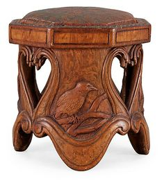 An Art Nouveau sculptured pine stool probably by Knut Fjaestad, Sweden early 1900's. Brown leather covered seat. H 39 cm | JV