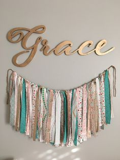 Goodwillista: Grace's Nursery | DIY banner | baby girl nursery | coral, teal l, gray and gold