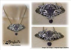 This stunning filigree layered necklace is made in bronze and brass with a professional coating of sterling silver. The silver pieces have been put through an oxidizing process that creates that beautiful antique silver look and helps to bring out the intricate details of each piece.  The two Gryphons guard a beautiful pure Amethyst stone that is set in a beautifully detailed frame with an overlay of silver.