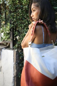 Need a beach or pool bag?! The Miami  has you covered! Water resistant leather, locking straps and zippers, RFID shielding pockets and slash-proof lining. You can leave your bag secured to your chair while you go on a walk down the beach or dip in the pool 💦 #myoffero You Bag, Zippers, Dip, Miami, Pockets, Handbags, Chair, Beach, Water
