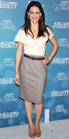 @Jennifer Garner  refined style (and flawless physique) in a sophisticated pencil skirt paired with a ruffled blouse. Finishing touches included round-toe pumps, hoop earrings and a heart-shaped locket.
