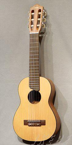 Yamaha Guitalele. This is a fun little travel instrument. I enjoy mine.