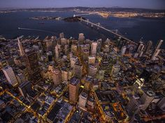 Photo // @jimmy_chin  Birds eye view of San Francisco the second most densely populated city in the U.S. besides New York City. In the distance can be seen the new segments of the Bay Bridge the most expensive public works project in California history estimated cost at $6.4billion. @thephotosociety by natgeo