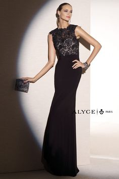 Chic and sleeveless, this Alyce Paris Black Label 5682 evening dress will be your best friend.  So complimentary, a lace bodice tops easy stretch Jersey for a wearable fit that moves with you.  Sheer lace is sweetheart lined with intricate sheer detailing and lacey edges on the jewel neckline and shoulders. The skirt is fitted and flared, full length and formal, for prom or any special event.  This look Available in Black, Royal, and Magenta, sizes 00 to 24.