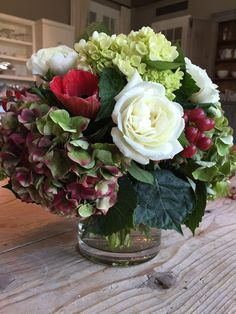 Ina Garten: Why do people only think of evergreens, holly, and bright red amaryllis as holiday flowers? I like to make arrangements that use a less traditional mix: red tinged hydrangeas, white roses and ranunculus, red anemones, plus lots of lime green hydrangeas and leaves to set them off- with red hypericum berries for a hit of deep red! The colors are traditional but the flowers are really interesting and they look as festive for New Year's as they do for Christmas!