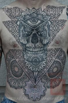 Sacred geometry and mandalas decorate this tattoo of a skull, eye of god and flowers, Thomas Hooper