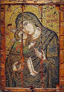 The Eleusa (or Eleousa) (Greek: Ἐλεούσα – tenderness or showing mercy) The Virgin Mary and the infant Jesus Christ nestled against her cheek.  In the Western church the type is often known as the Virgin of Tenderness.