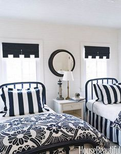 painted iron beds to match the navy and white bedding from anthropologie make for a contemporary ecletic look...