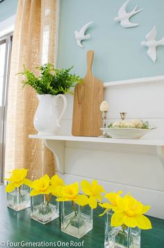 How to decorate a simple white shelf with using a white pitcher + vases from Home Goods