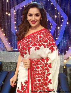 Ravishing and resplendent, among the bloom of #redflowers on this ethereal white and red #embroiderysaree, #MadhuriDixit looks like a rose herself! MuaA to you #queen of hearts!