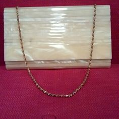 Beautiful Evening Bag This beautiful evening bag comes with a long removable chain. The quality of this bag is superb. Its in pristine condition. The texture is that of a hard plastic. No dings or chips anywhere. It is very shiny and has a pearly cream sheen. Will be the perfect bag for wedding or party attire. none available Bags Clutches & Wristlets