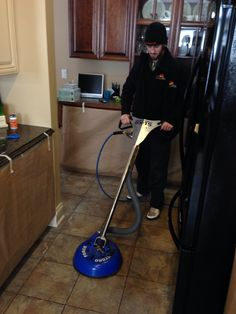Kyle doing tile & grout cleaning.