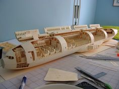 A 1:60-Scale Boeing 777 Made Entirely From Paper Manilla Folders