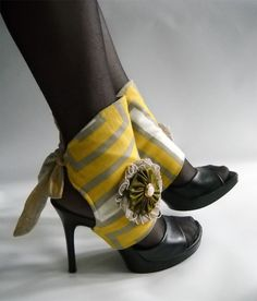 Spats and gaiters for shmancy shoe coverage, via Offbeat Bride. These are cute! Why aren't *spats* trendy instead of ankle bootie-hooves? (Because there's no justice in trends, that's why.)