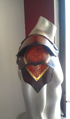 Leather shoulder armor.  Trying to piece together the armor of an Emberlian soldier.  With the band of gold this could definitely be Emberlian.