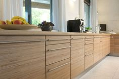 modern birch kitchen cabinets - Google Search - Note that the grain is running horizonally, not vertically as is typical in a cabinet. I like this look!