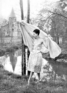 Model is wearing strapless dress embroidered in blue with sky blue-chiffon wrap by Pierre Balmain, photo by Philippe Pottier at Château Royal du Vivier-en-Brie, 1961