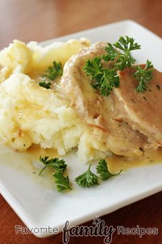Crock Pot Pork Chops -- Only 4 ingredients, 5 minutes of prep time AND your family will devour it!! You simply can't go wrong with this recipe!