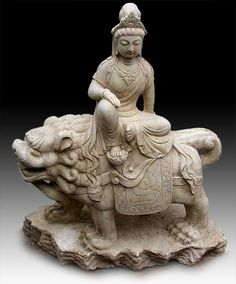 Chinese White Marble Quan Yin Buddha Riding On Snow Lion - Possibly Manjusri Buddha - Qing to Early Republic, circa: 1900 H. 30 in. (76cm) X W. 26 in.(66cm) X D. 13 in.(33cm) -  The boddhisattva Quan Yin is shown riding a snow lion, symbol of bravery and guardian of the Buddhist dharma.