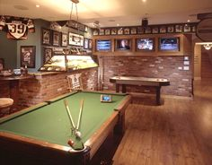 mini bar/game room with a billiards table, air hockey game, dartboard, fully stocked bar and a jukebox