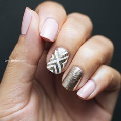 Brides.com: 15 Sparkly Manicures to Rock with Your Engagement Ring A pink manicure with gold decals and sparkle.Photo: es Nail via Instagram