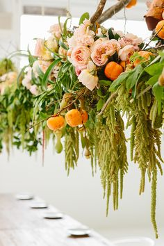 Woodland wedding floral chandelier with pink roses, amaranthus and oranges | Fifteen Photography