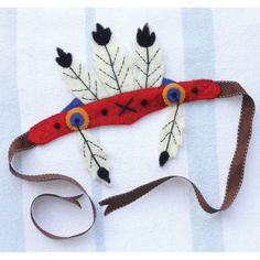 native american feather headdress by sew heart felt | notonthehighstreet.com