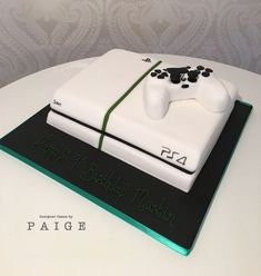 Playstation 4 with Controller . Sleek looking Playstation 4 cake complete with controller too. Both console and controller made from cake for an impressive Teen Boy Birthday Cake, Funny Birthday Cakes, Birthday Cakes For Men, Birthday Cookies, 16th Birthday, Teen Boy Cakes, Nintendo Cake, Sweet 16 For Boys, Playstation Cake
