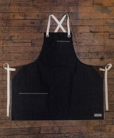 Our Kyoto Bib Apron has a smaller body width and length. It's perfect for our more petite customer, or anyone looking for a little less coverage. The ties on this apron are a crossback style (see phot