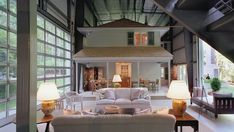 Architect Adam Kalkin decided to enclose his cottage in an airplane hangar.
