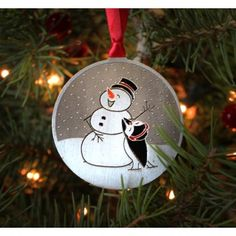 A charming little penguin building a happy snowman is sure to bring a smile to everyone's face this holiday season! Snowman Ornaments, Christmas Ornaments, Handmade Christmas, Penguins, Artisan, Smile, Seasons, Holiday Decor, Building