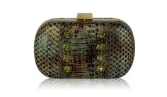Painted then studded with SWAROVSKI ELEMENTS set crystals, this genuine INGE CHRISTOPHER snakeskin minaudiere is a unique statement piece.