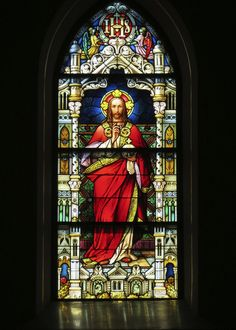 Stained glass window of Jesus Christ at Gesu Church.