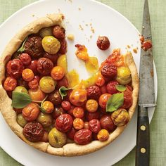 Have you ever tried a tart made almost entirely of cherry tomatoes? Now might be the time.Have you ever tried a tart made almost entirely of cherry tomatoes? Now might be the time.