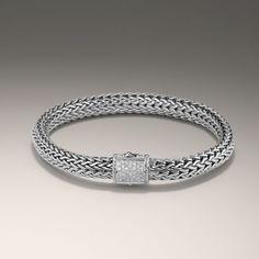 Simple, rope-like silver bracelet.