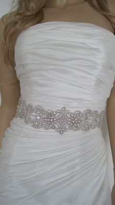 "Crystal bridal sash belt Wedding dress beaded sash belt rhinestone black white ,gold ivory ""ANA"". $89.00, via Etsy.---hers is off center but i would put a teal sash behind it"