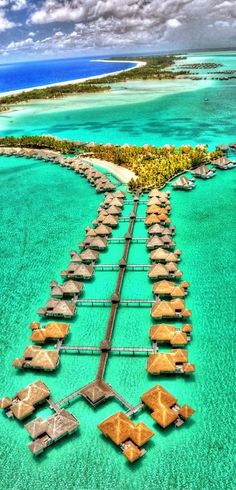 Overwater bungalows or Ocean Huts are iconic, thatch-roo...